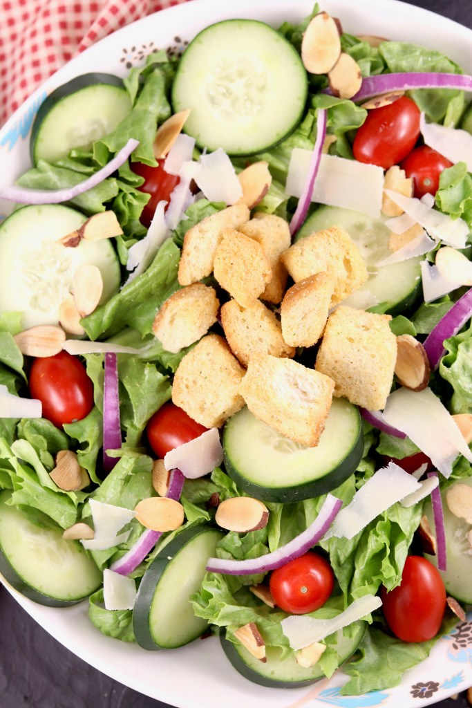 Green Salad with red onion, tomatoes and cucumbers