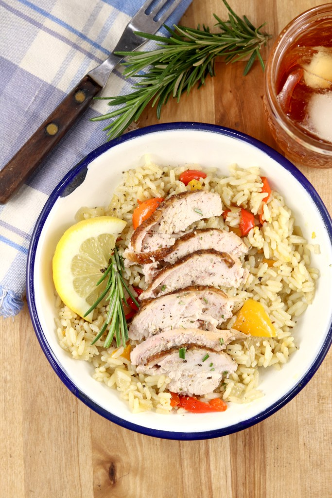 Sliced smoked chicken with rice pilaf