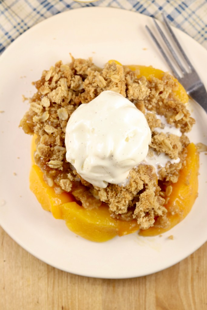 Peach crisp topped with ice cream