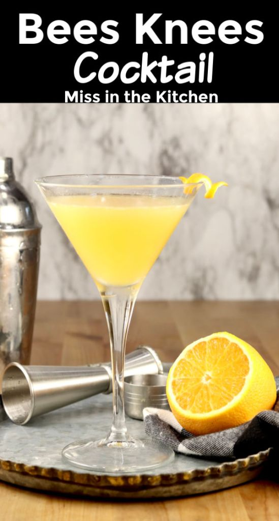 Bees Knees Cocktail in a martini glass with a lemon half on a tray