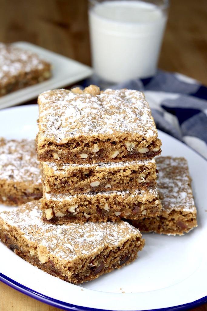 Plate of date and nut bars with powdered sugar