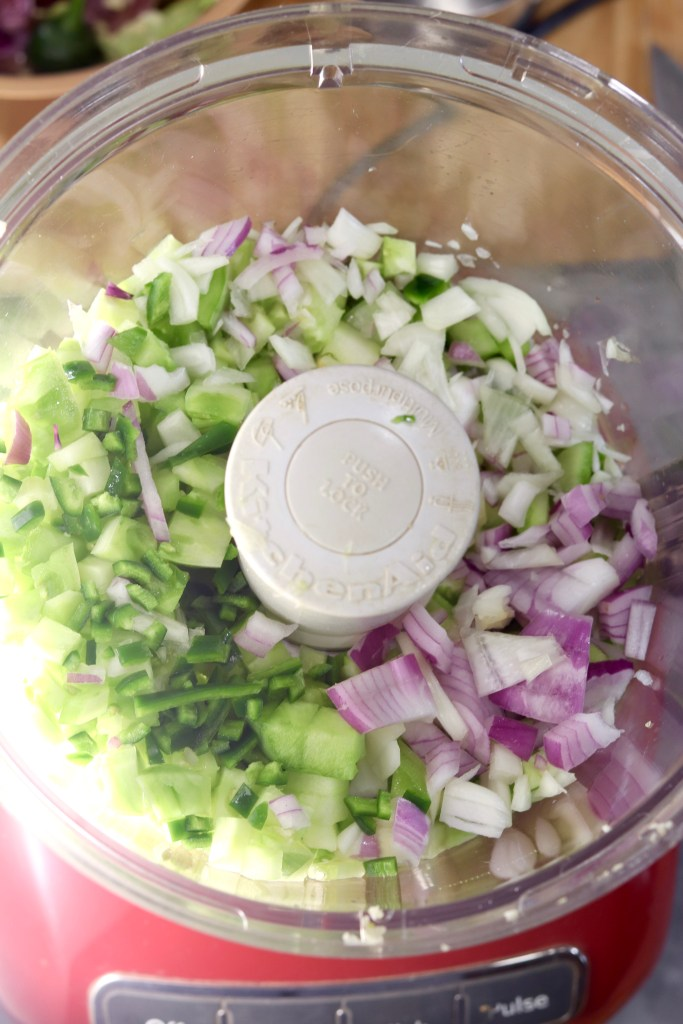 green tomatoes, onion, garlic and vinegar in a food processor