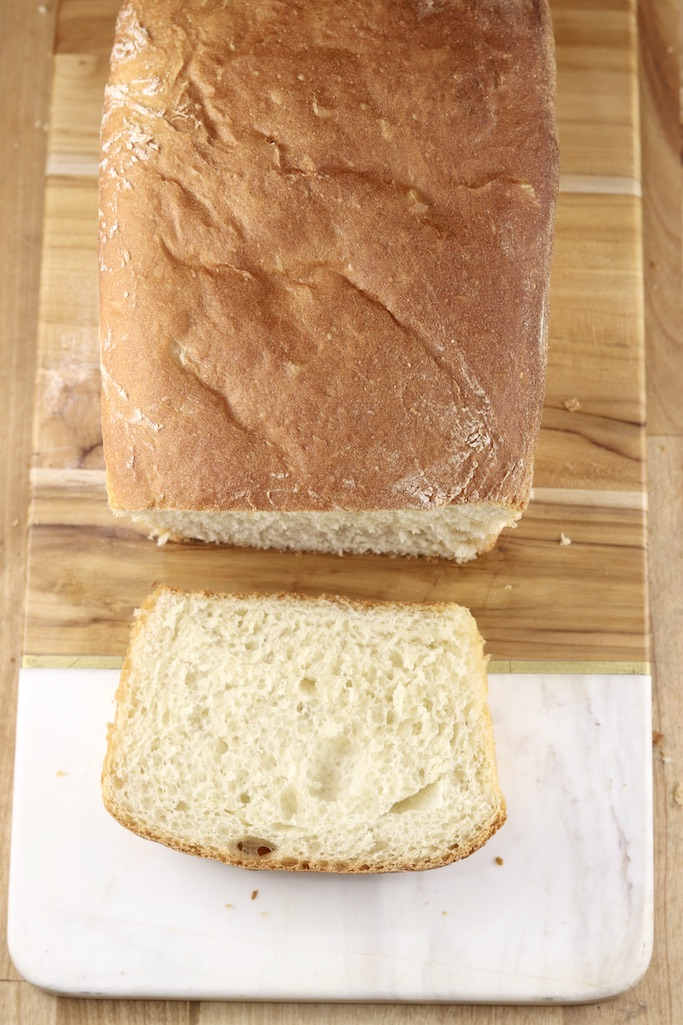 Overhead view loaf of white sandwich bread with end sliced
