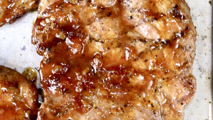 Peach BBQ Pork Steak close up with grill marks
