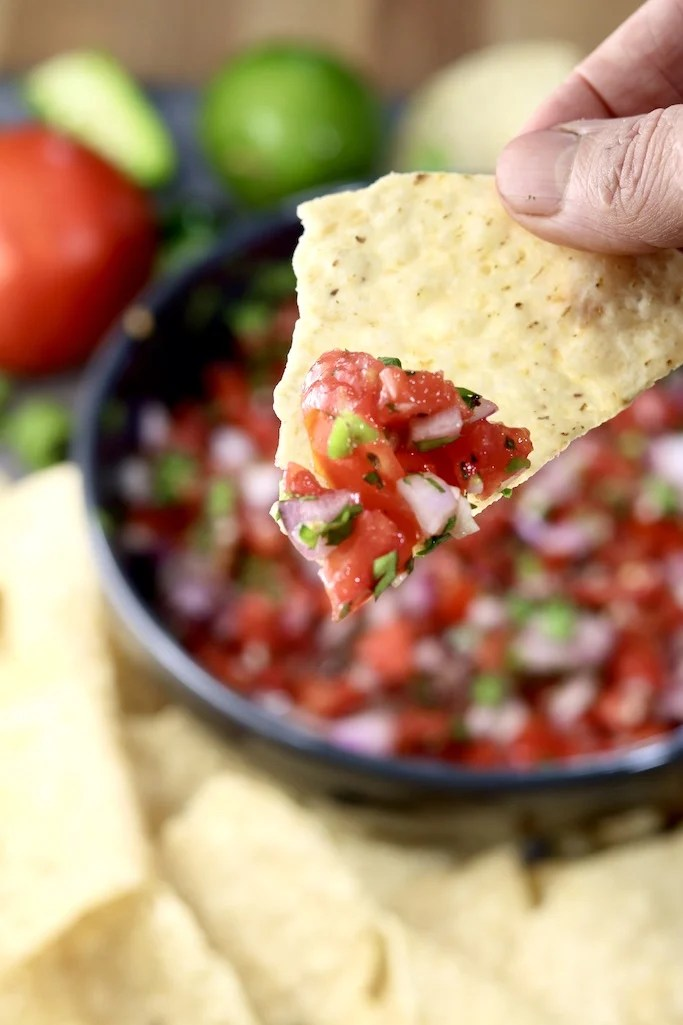 Pico de Gallo served on a tortilla chip, close up view