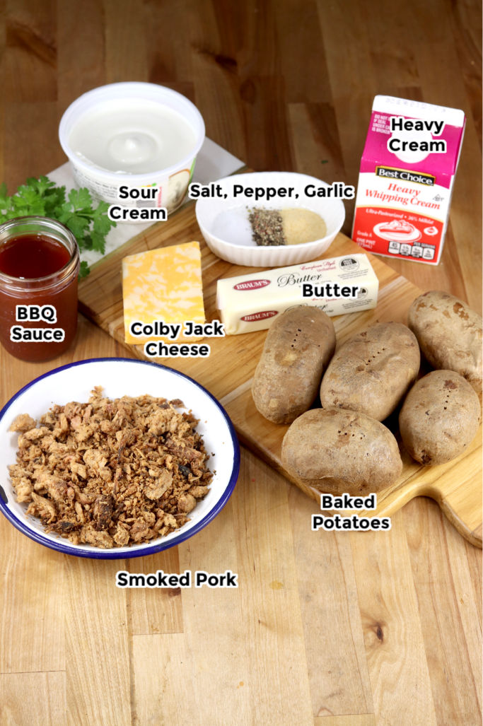 Ingredients to make pulled pork twice baked potatoes- butter, sour cream, cheese, bbq sauce