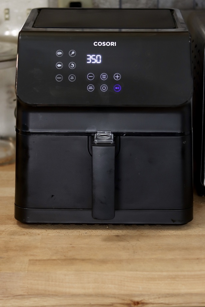 Cosori Air Fryer on cabinet