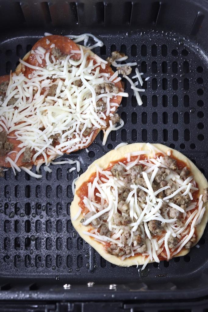 2 mini pizzas in air fryer basket
