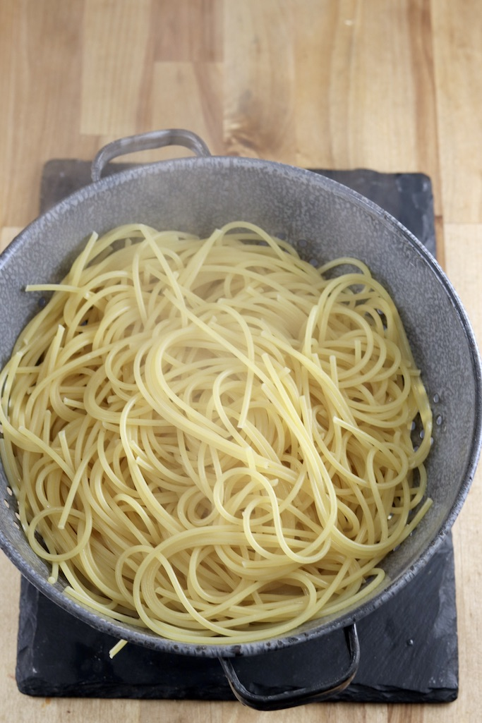 Colander of cooked and drained spaghetti