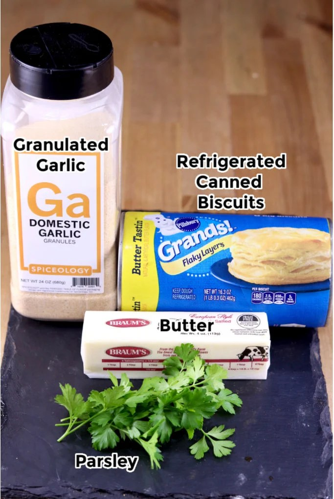 Ingredients for Air Fryer Breadsticks: granulated garlic, canned biscuits, butter, parsley