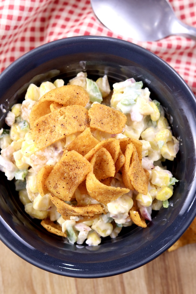 Bowl of corn salad topped with Fritos