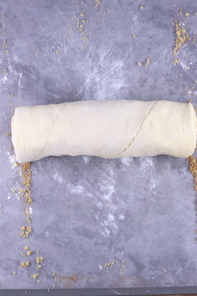 Roll of apple cinnamon rolls dough