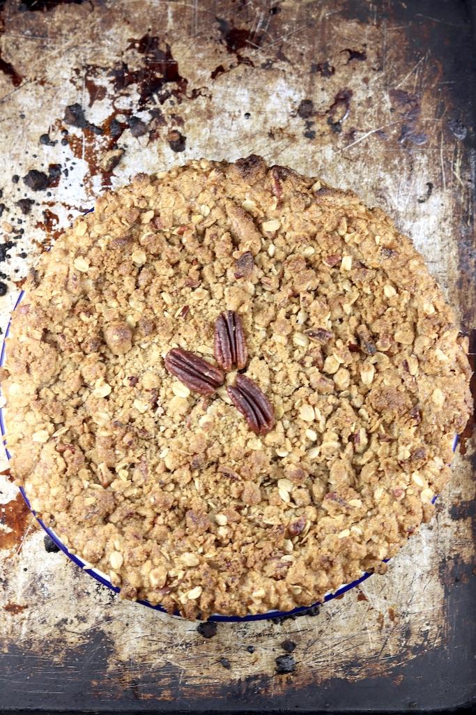 Baked pumpkin pecan crisp on a baking sheet- overhead view