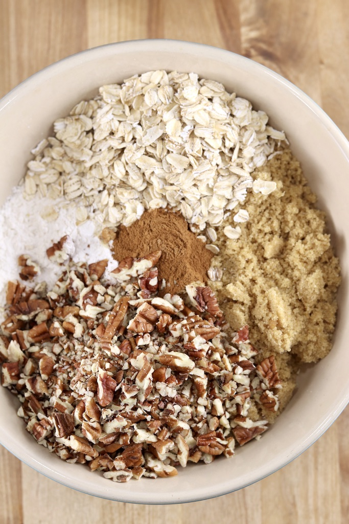 bowl with flour, pecans, brown sugar, oats, cinnamon for pumpkin crisp