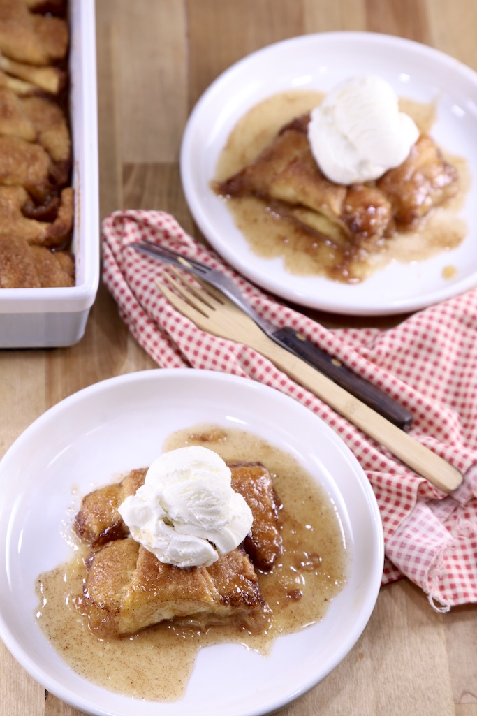 2 plates of apple dumplings with vanilla ice cream