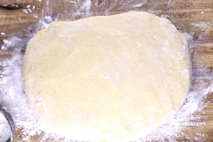 Dinner roll dough on floured board