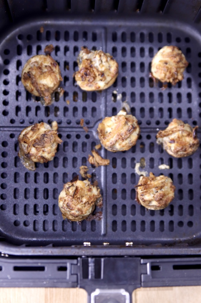 Sausage stuffed mushrooms cooked in an air fryer basket