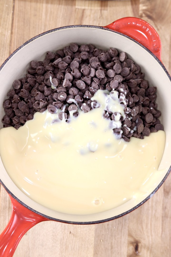 Chocolate Chips with sweetened condensed milk in a pan for making fudge