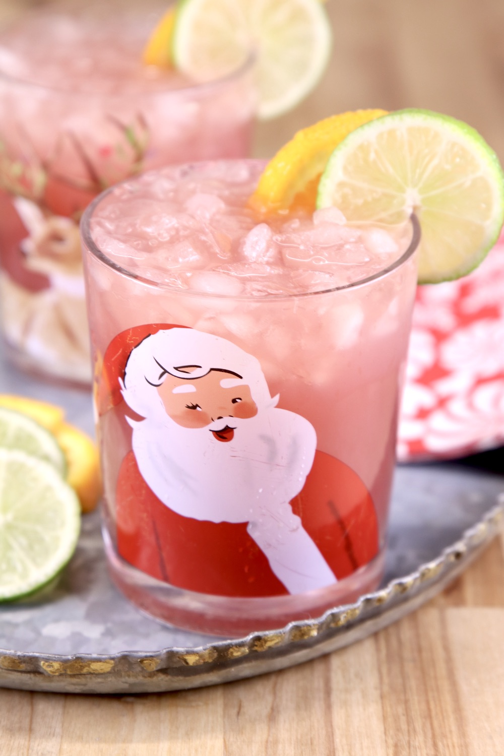 Cranberry Punch in a Christmas Glass garnished with lime and orange slices