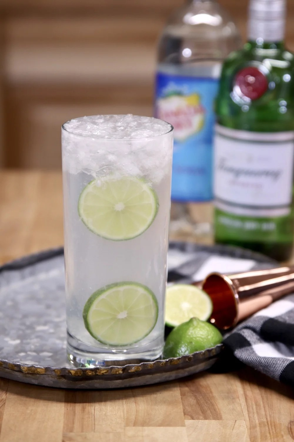 Gin Rickey Cocktail with gin and club soda in background