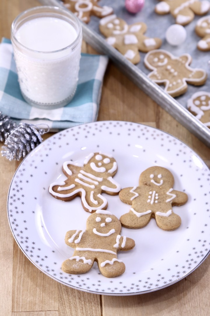 Gingerbread Cookies on a plate with a glass of milk