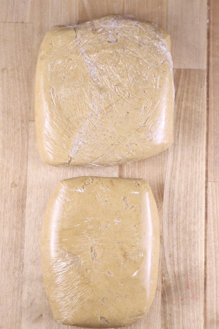 Gingerbread Cookie Dough in 2 squares wrapped in plastic wrap.