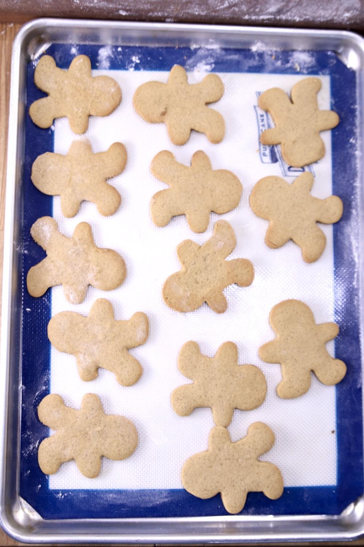 baked gingerbread men cookies on a cookie shhet