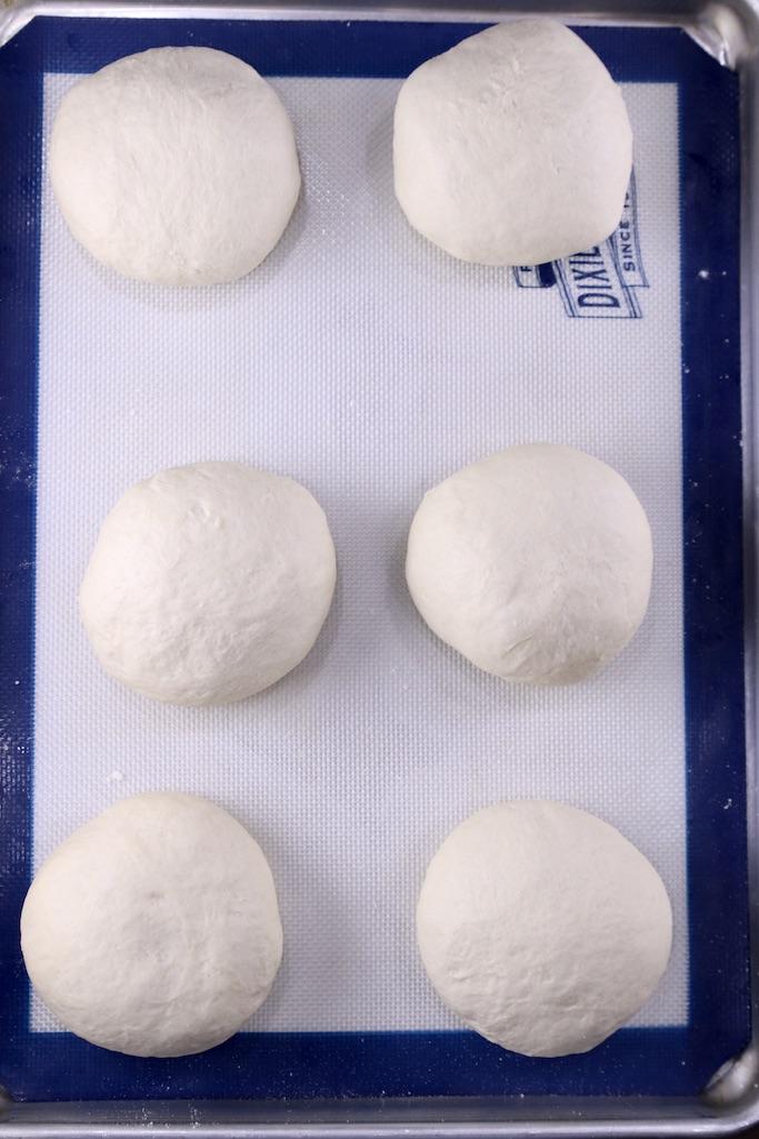 Bread bowl dough ready to rise on a baking sheet