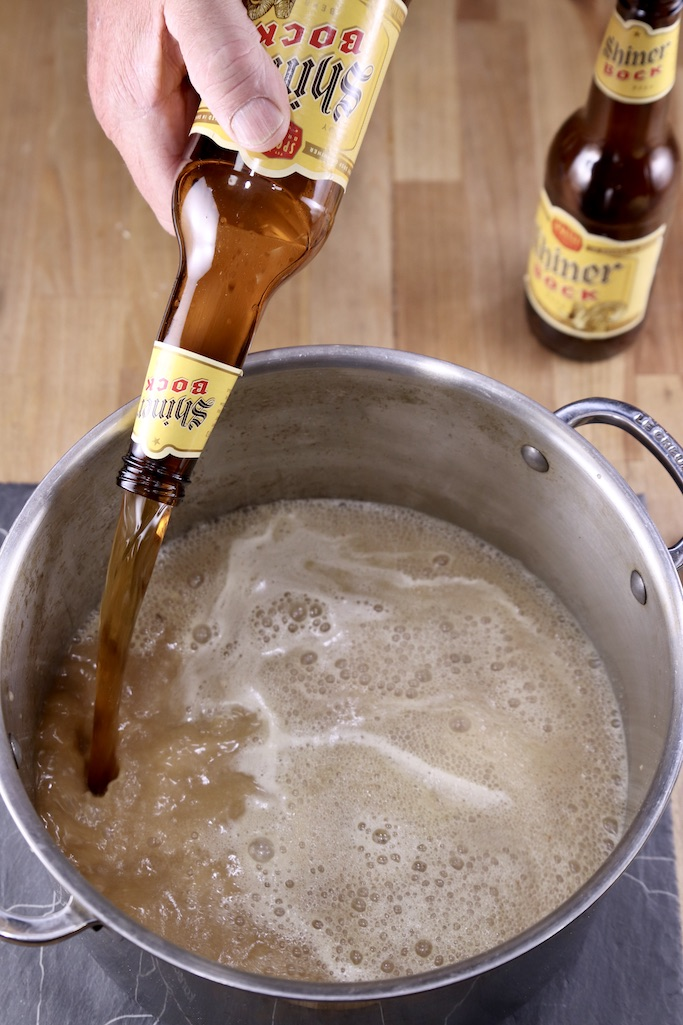 Pouring Shiner Bock beer into a soup pot