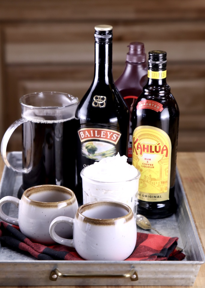 Ingredients for Mudslide coffee on a tray with 2 mugs