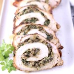 Sliced stuffed pork tenderloin on a platter