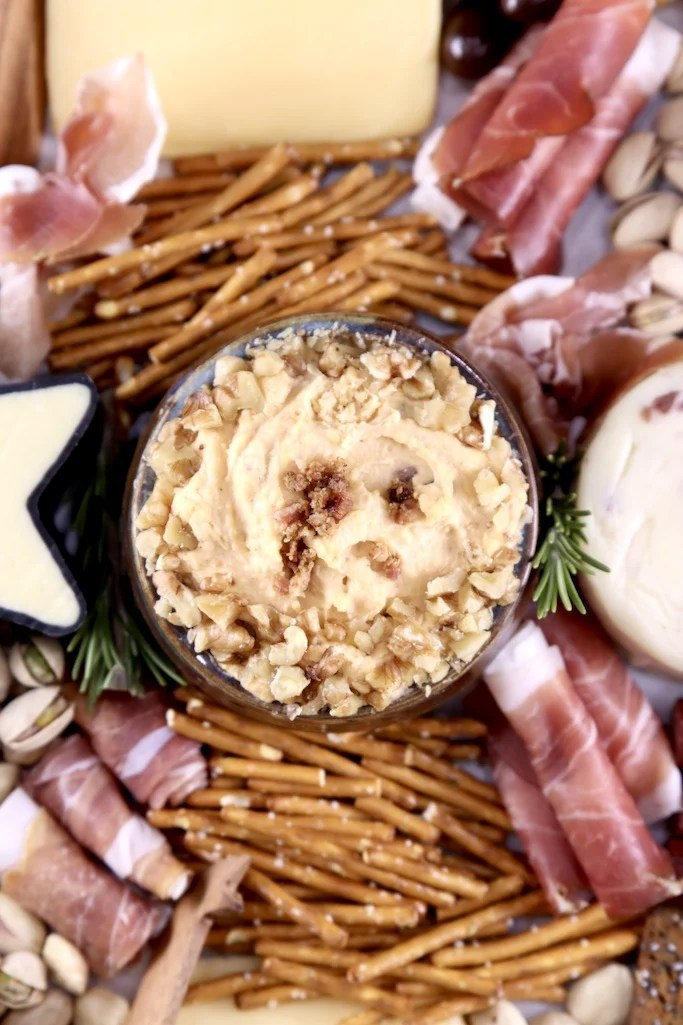 Charcuterie board with beer cheese dip, pretzels, cheese and meats