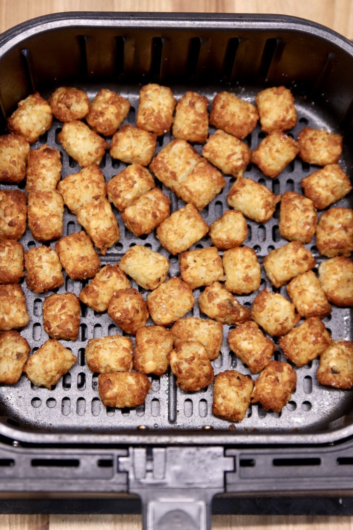 Air Fryer with cooked tater tots