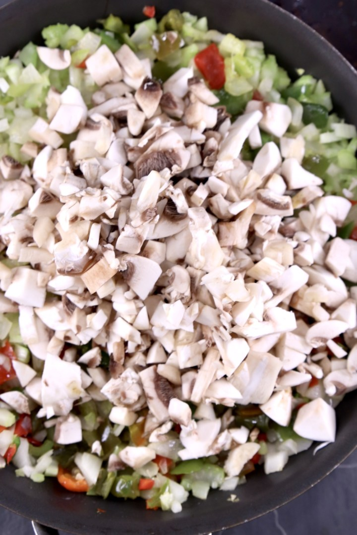 diced mushrooms added to pan of onions, celery, bell peppers