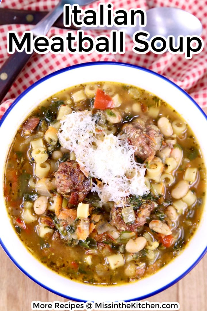 Italian Meatball Soup in a bowl with grated Parmesan, text overlay