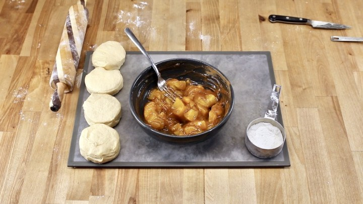 bowl of peach pie filling with can biscuits for air fryer dessert