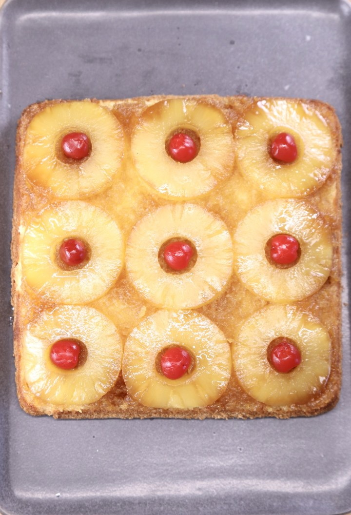Pineapple Upside Down Cake - square with pineapple rings and cherries in the center