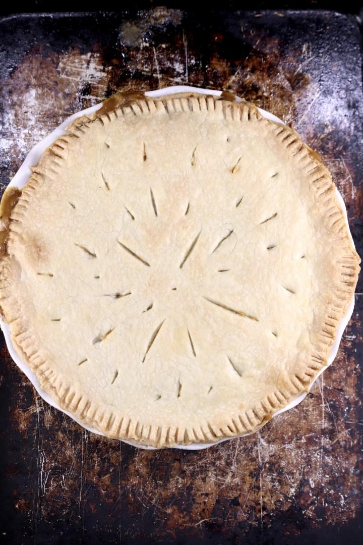Baked crawfish pie on a baking sheet