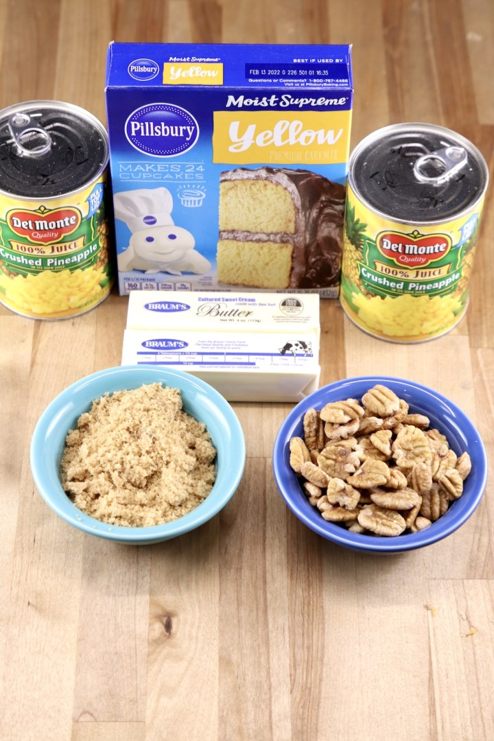Dump Cake Ingredients: 2 cans crushed pineapple, yellow cake mix, brown sugar, butter, pecans