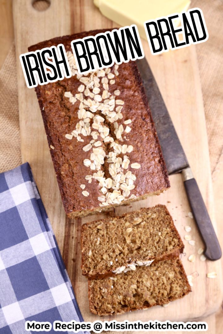 Irish brown bread loaf on a cutting board with knife and butter