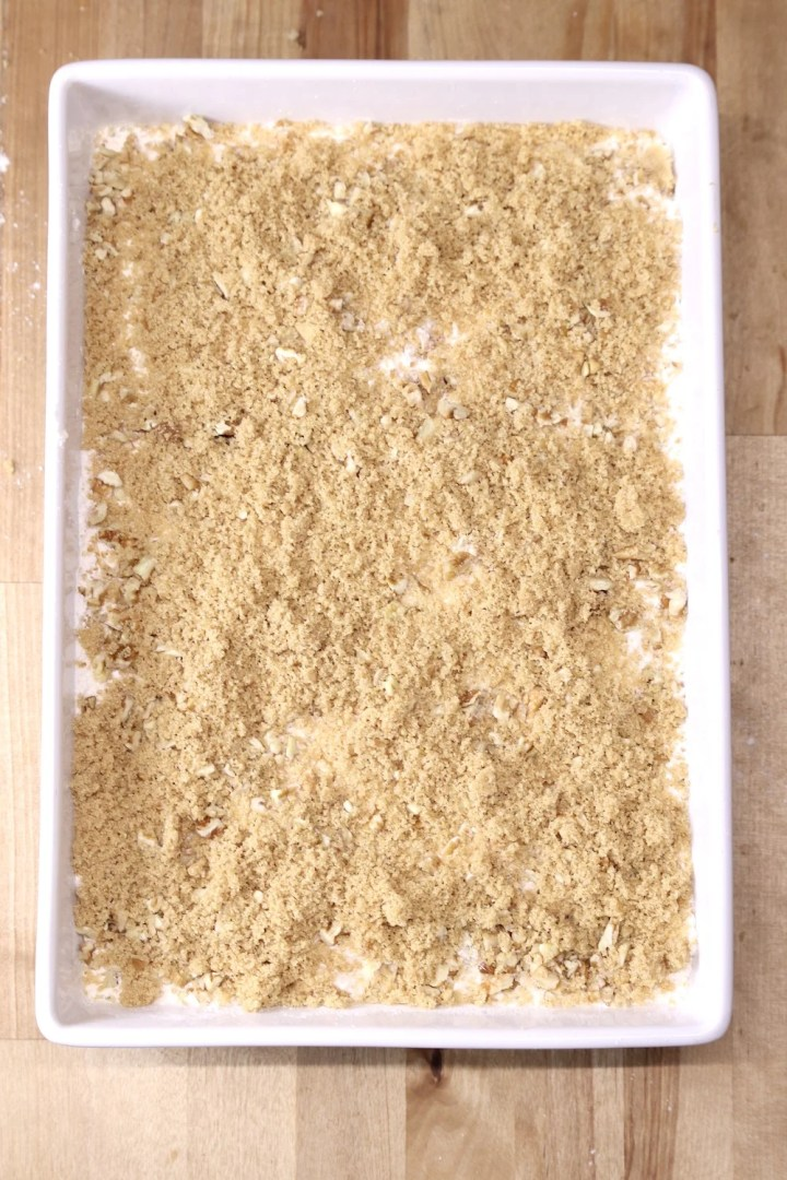 dump cake sprinkled with brown sugar layer