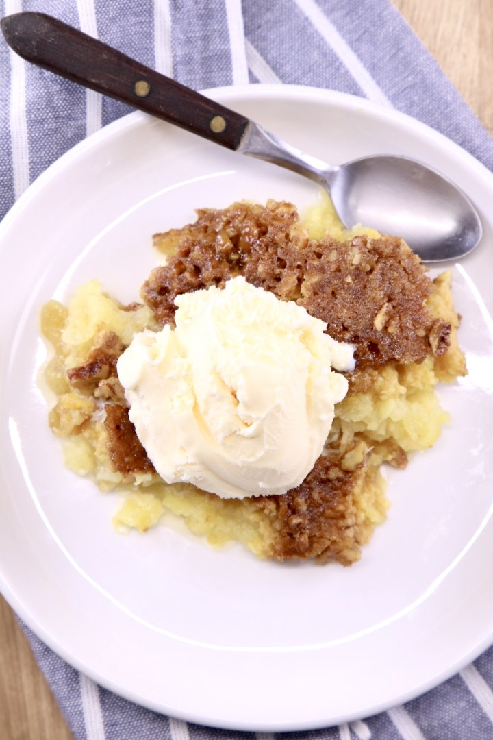 Pineapple Dump Cake topped with vanilla ice cream