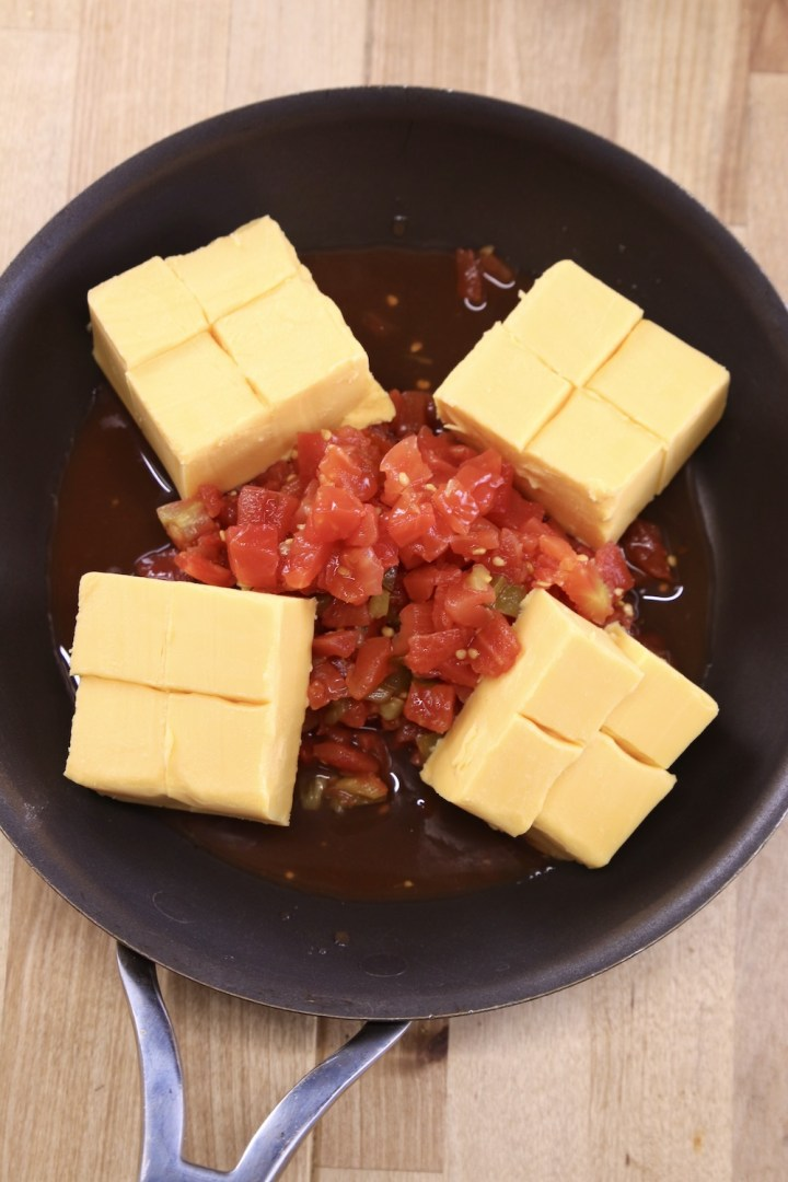 chunks of Velveeta with RoTel tomatoes in a non stick skillet