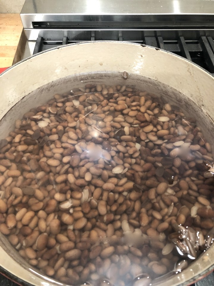 Pinto beans in a pan with water
