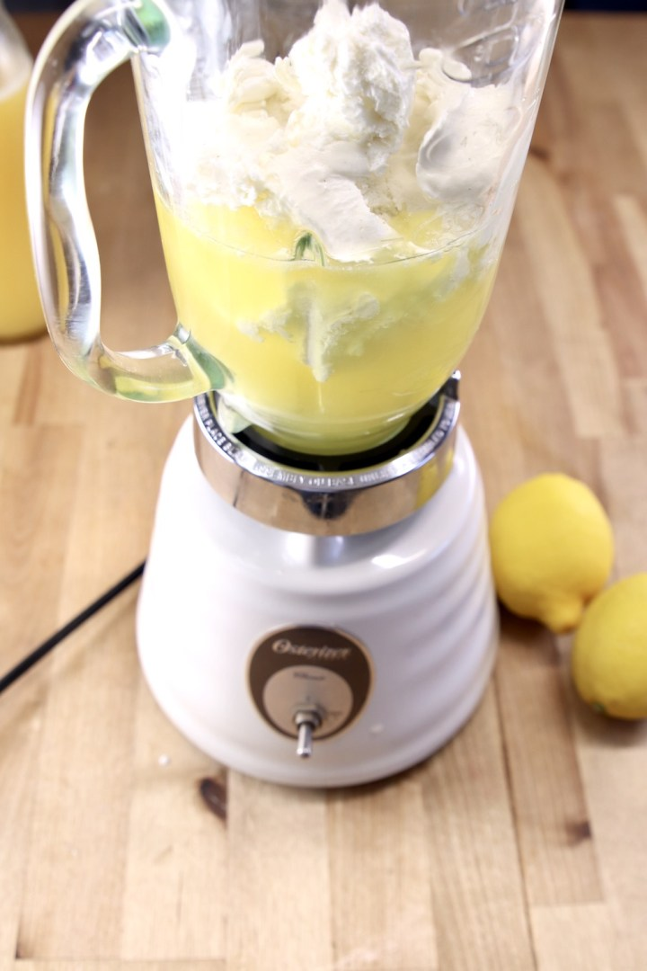 blender with pineapple juice and ice cream