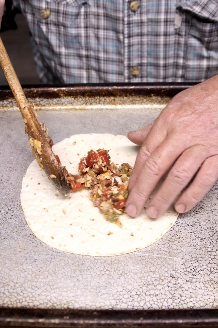 Filling flour tortillas with short rib filling