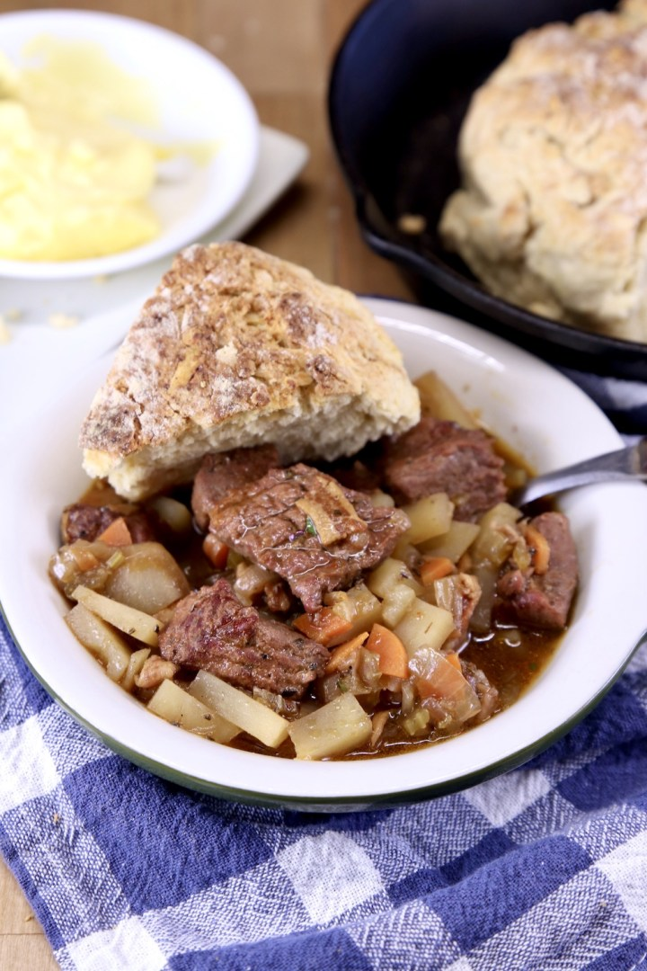 Beef stew in a bowl with Irish soda bread