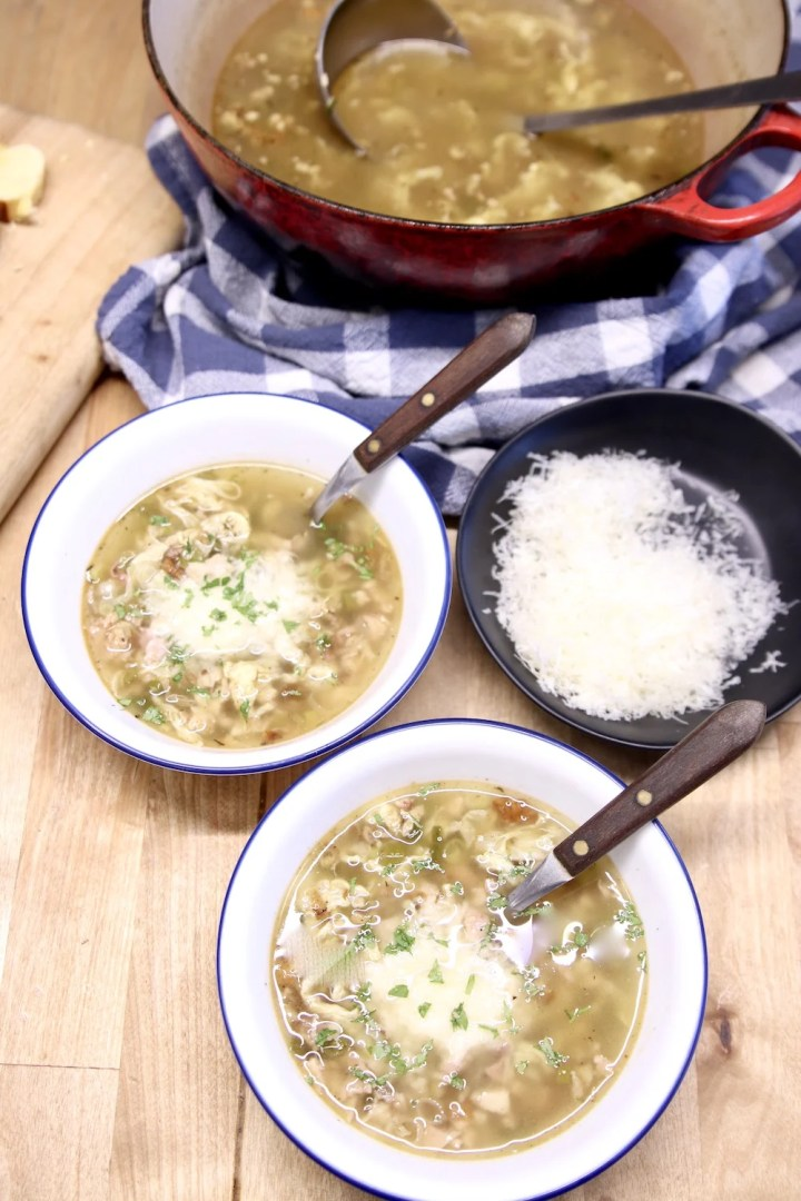 Stracciatella Soup with parmesan cheese, 2 bowls, soup pan and bowl of cheese