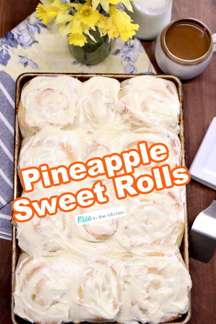 pan of pineapple sweet rolls with cream cheese icing -text overlay