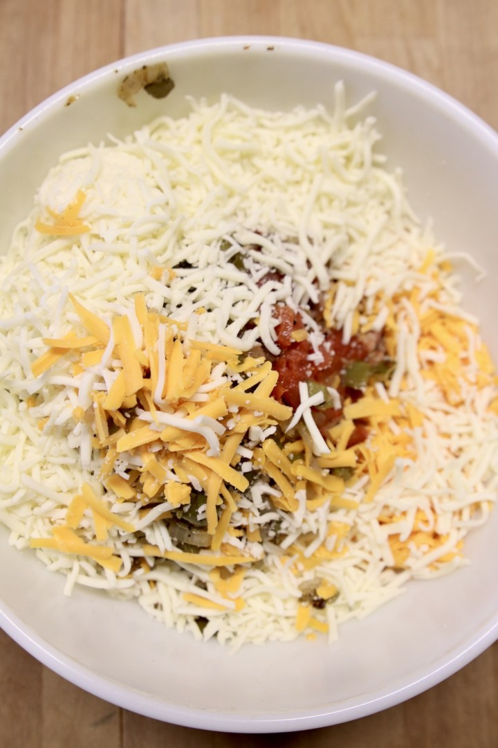 Bowl with burrito filling and shredded cheese